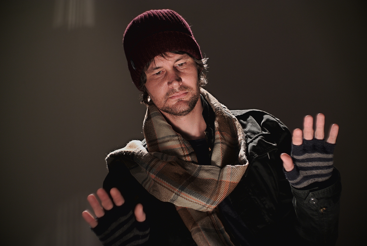 Franc's Advanced Photography workshop is a place to learn how to tell a story with specific lighting. Here, student Lee Webb as a homeless warming up near a fire.