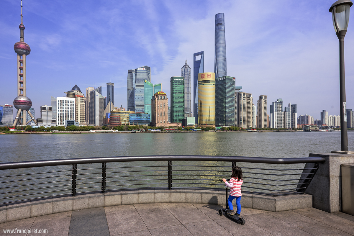 The little girl on The Bund and the Skycraper.