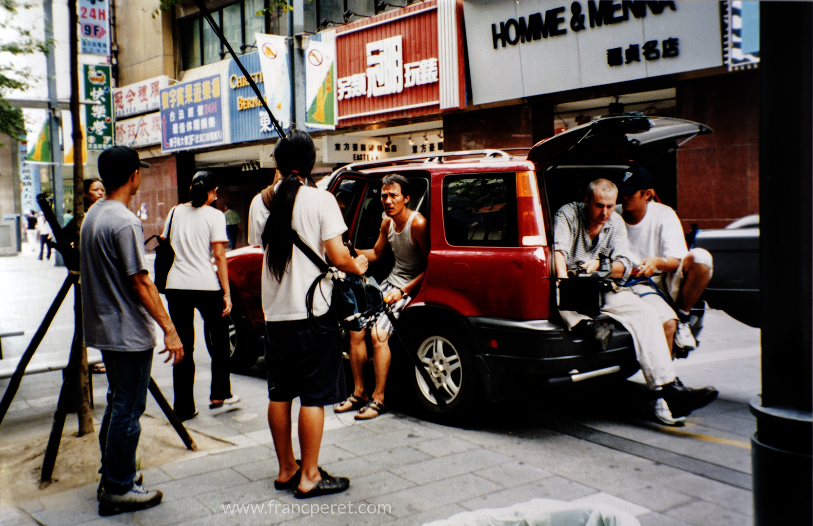 The personal car of the Director was used a the dolly to track some running shots in the street of Taipei.