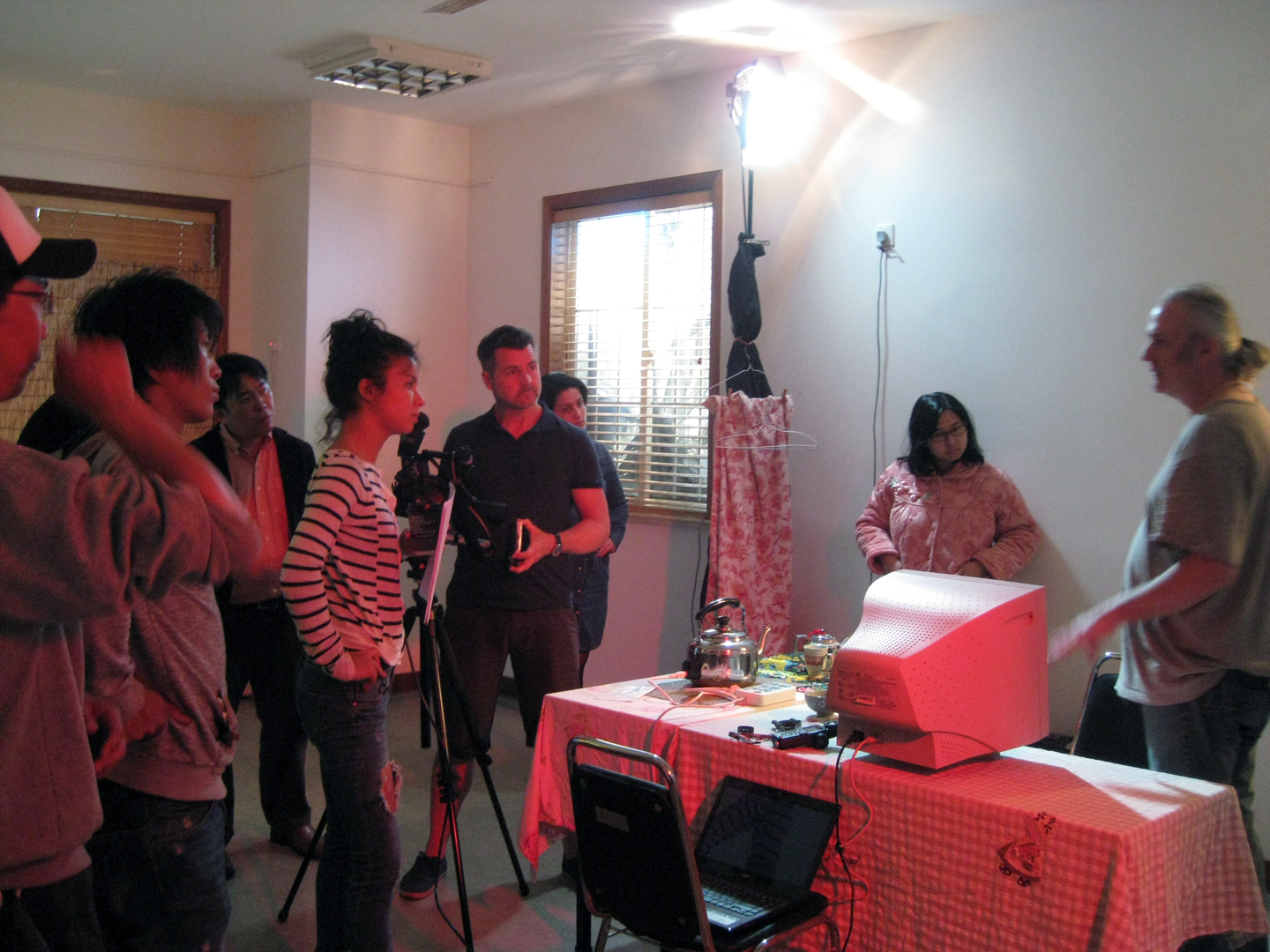 Watching TV set up with actors and assistants