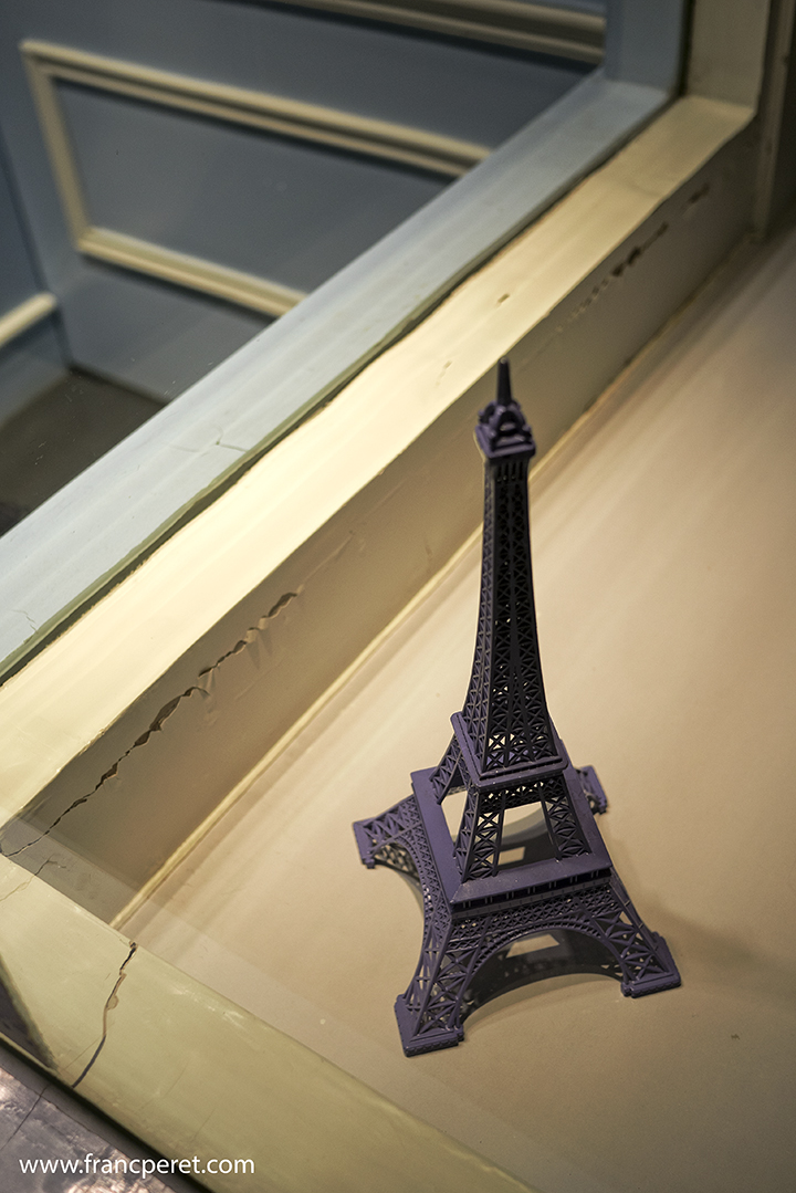 Lonely Tour Eiffel in a store. Light source direction are unusual at night bringing some magic to anything.