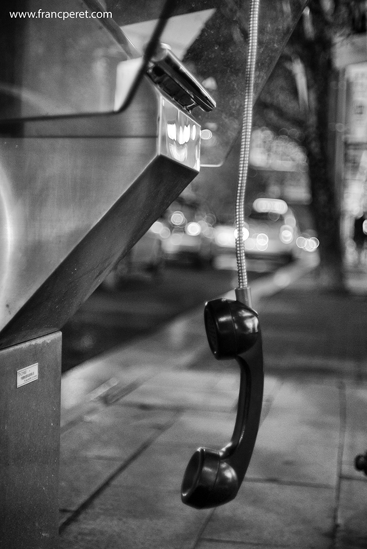 Getting the phone hanging was a way to capture the interesting metallic link holding it in front of the breaking cars in the background.