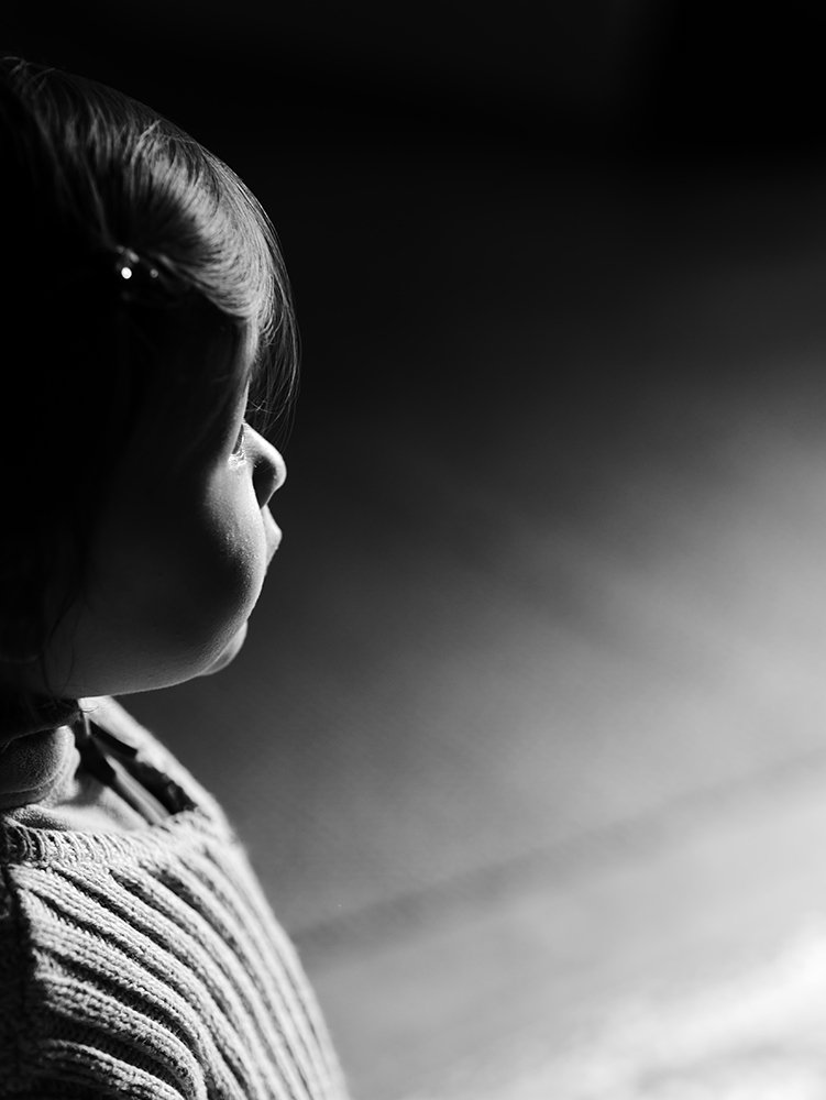 My little one looking at the main door bathed by soft natural light. Lumix GM5 ISO200 1/160s with 45 mm f/1.8 @ f/1.8