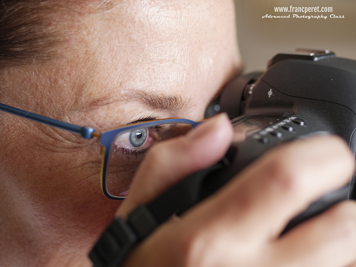 Monja's concentration through her Canon 5D Mark IV viewfinder. Shot by Franc with a Panasonic G85 and Leica 25mm f/1.4