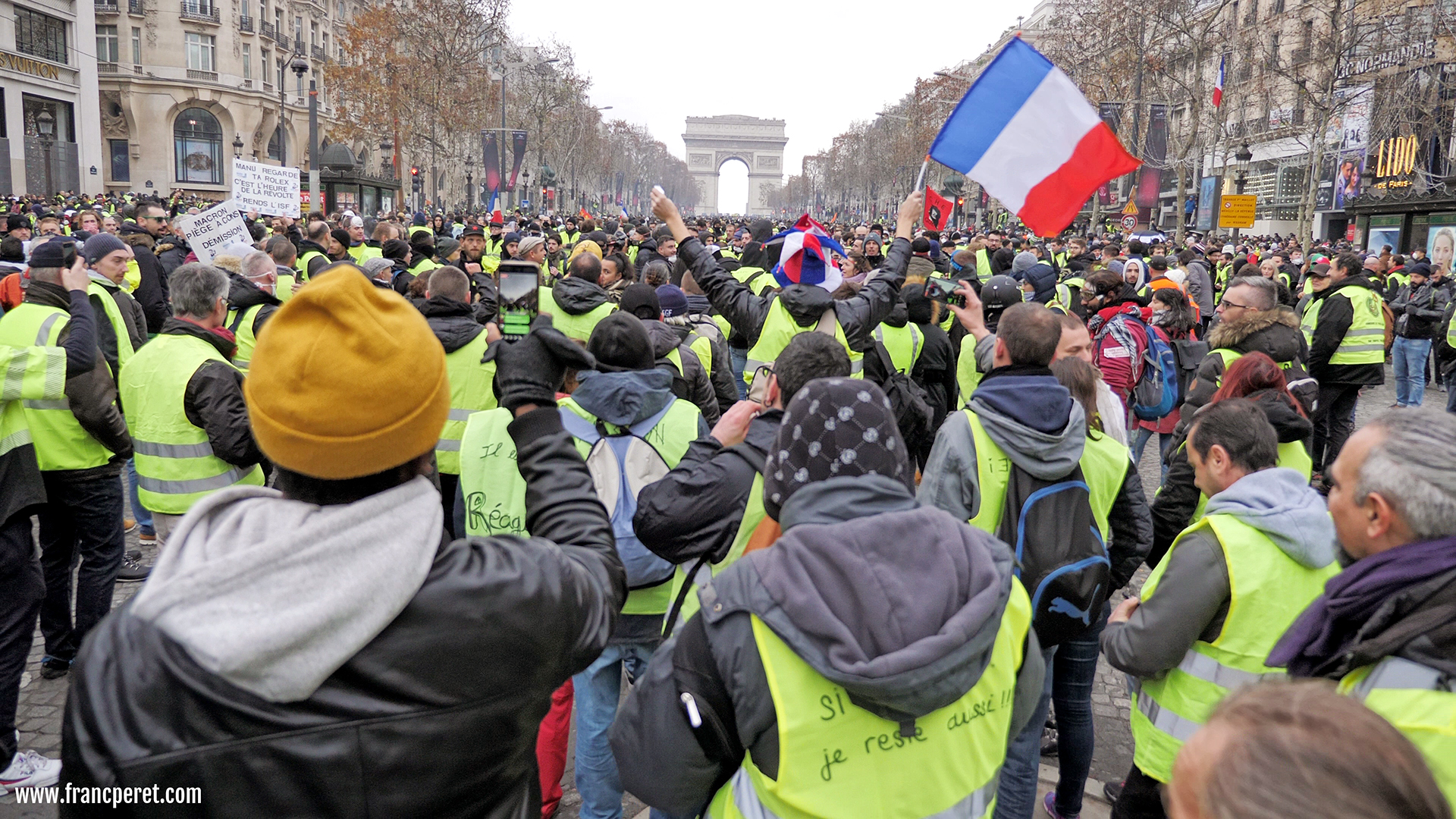The leftover countryside crowd filling the luxury avenue of Champs Elysees.